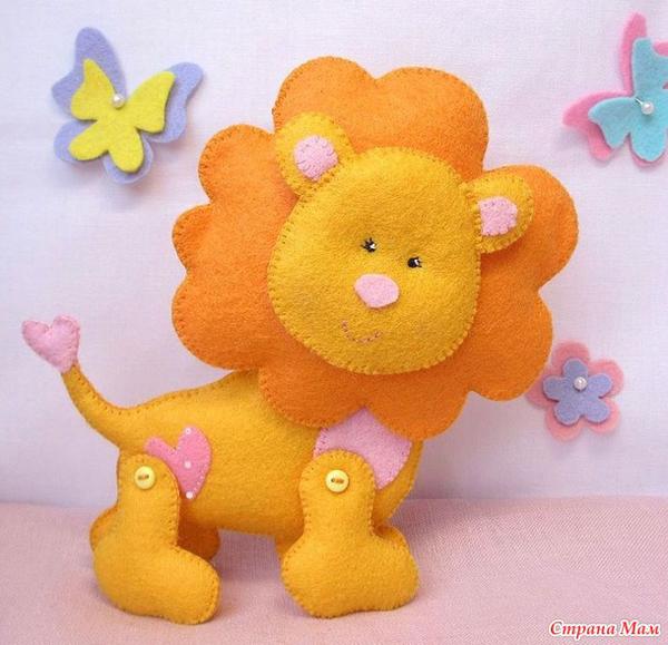 artesanías de fieltro de león
