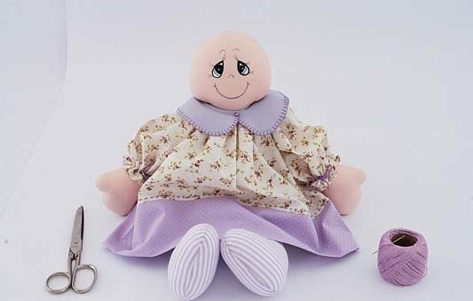 muñeca de tela con ropa
