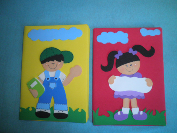 cuaderno con eva niño y niña