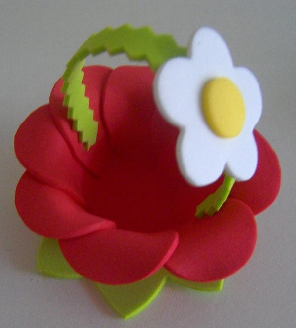 puerta de bombón en cesta de flores eva
