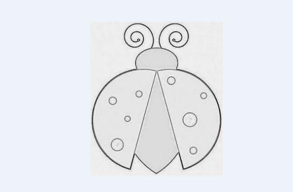 mariquita con molde de ala abierta