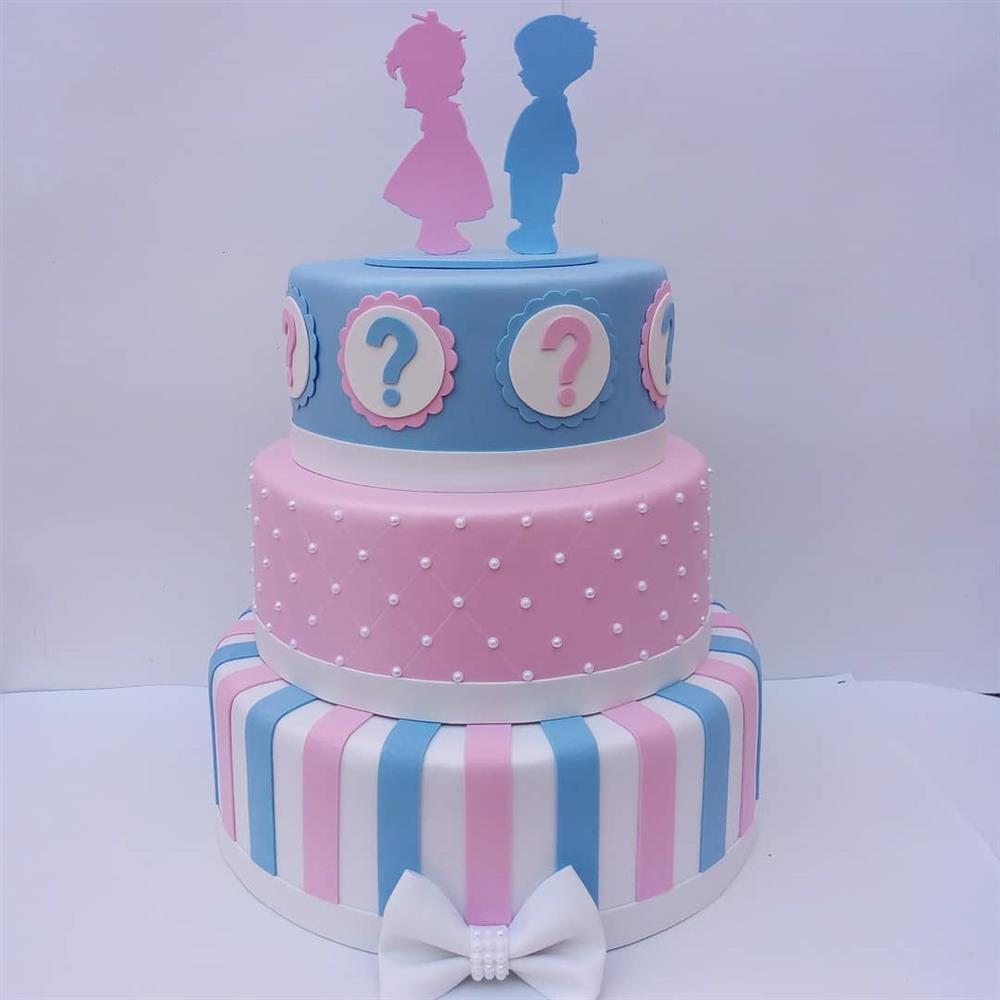 falso pastel de revelación azul y rosa