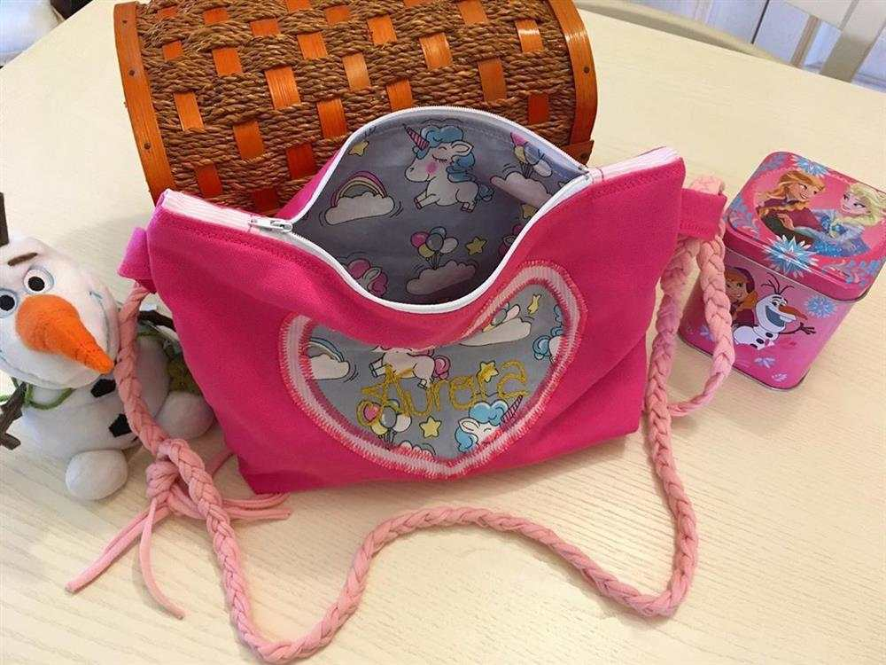 Monedero infantil de tela rosa