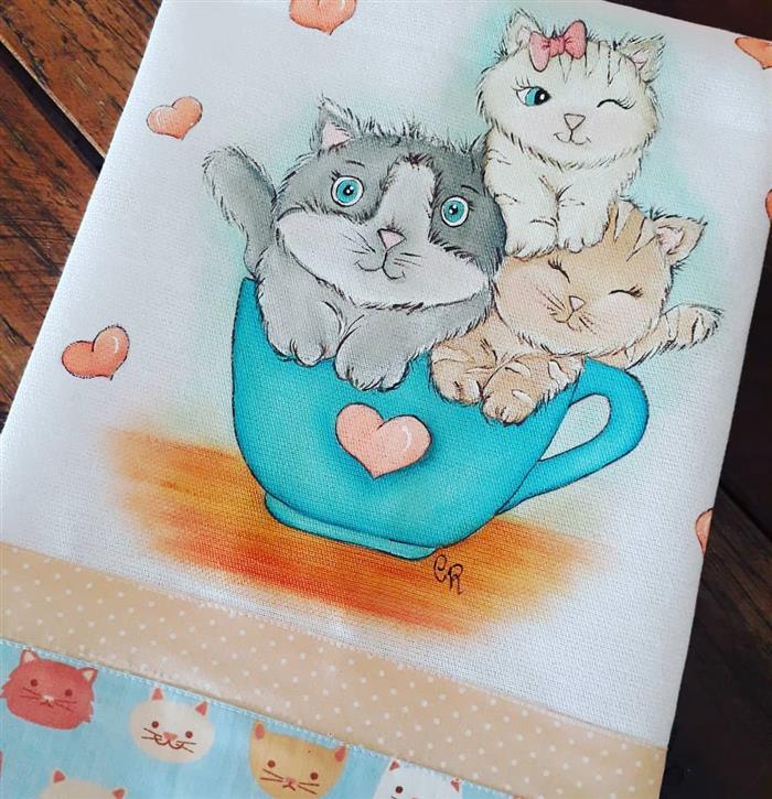 pintura sobre gatos de trapo